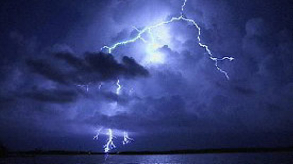 Property of http://www.thesonsofthunder.com/images/blue%20lightning%20over%20water.jpg